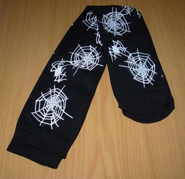 Black thigh highs with white spider web print