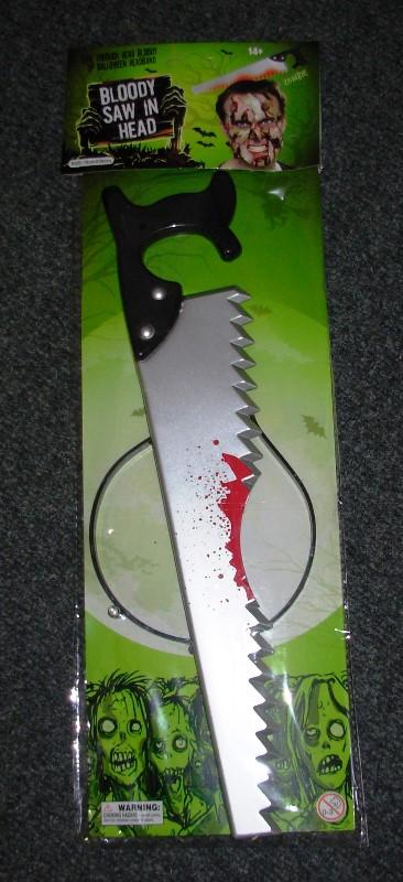 Bloody saw through head