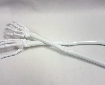 White skeleton hand serving tongs