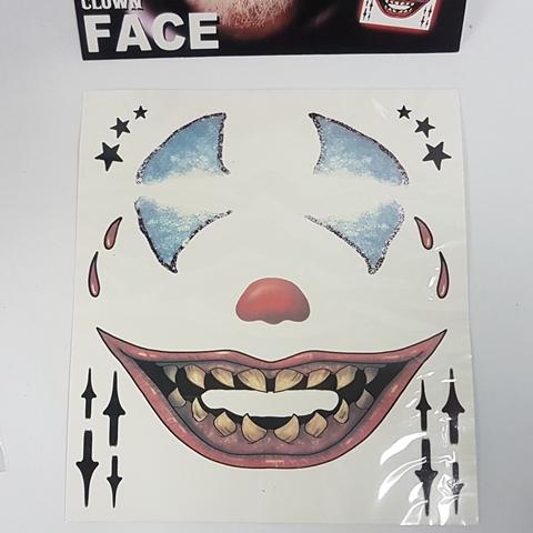 Creepy clown tattoo