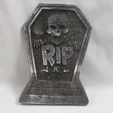Tombstone with skull design