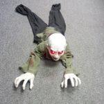 Crawling zombie man